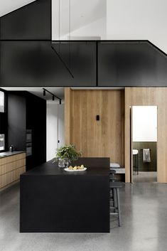 Dekton Sirius is used in this modern home designed by Heartly. Kitchen countertop, bench and pantry uses its dark black colour, striking complement and contrast to the solid American oak and blackened American oak veneer for joinery. It also makes a high impact, along with the concrete floor. Find more modern and industrial inspirations for your kitchen and bathroom ideas at Cosentino.com #Dekton #byCosentino #industrialdesign #blackkitchen