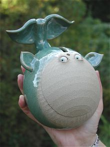 Handmade whale piggy banks - this would be a great for a nautical themed room.