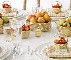 i love this idea.. fruits as centerpieces!! maybe use vases or another kind of wicker basket.