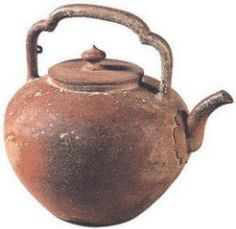 """High Handle YiXing teapot from Wu Jing tomb   Declared to be """"the great grandmother of YiXing teapots."""" from 1533, comes from the tomb of a palace servant iand was used to boil water instead of steep tea Currently in the NanJing Museum and is beyond price."""