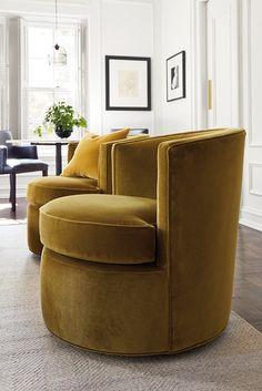 Velvet swivel chair with a modern twist.