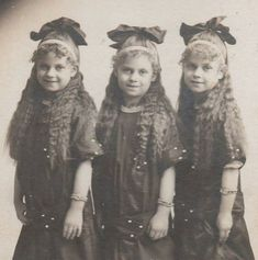 Identical triplets, girls, cute, nuttet, posing, vintage, photo, history, similar out fits, incl. hair styling.