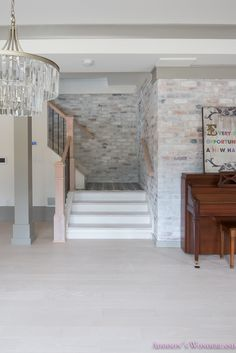 Sharing a peek at our basement post-construction as well as our beautiful new whitewashed hardwood flooring and brick walls!