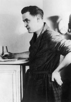 American author F. Scott Fitzgerald (1896-1940) writes in a notebook on top of a dresser, wearing a bathrobe, 1936 (Photo by Hulton Archive/Getty Images) -