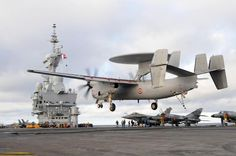 French Marine Nationale Aircraft Carrier (Port-Avions in French parlance) Charles de Gaulle celebrates her 32000th landing as a Grumman E-2 Hawkeye AWACs lands on, around 1400hrs December 26th 2013.Entire French E-2 fleet slated for upgrade in near future.
