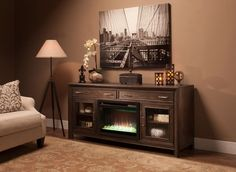 "The Woolbrook 68"" TV console with electric fireplace will do so much more than hold your TV and electronics—this media console will instantly enhance the ambience of your room."