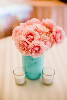 Aqua jar with pink roses.  Event Planning: Azalea Events. Photography: Bethany And Dan Photography - www.bethanydan.com