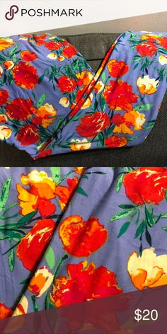 "LuLaRoe leggings - TC - flowers 🌺 💐 If you haven't tried LuLaRoe leggings you are truly missing out! They are comfortable- muffin top free and so buttery soft you'll be telling total strangers to ""FEEL MY LEG!"" This is a TC pair with a muted blue background and vivid flowers in shades or red, orange & yellow- they almost appear painted. They're gorgeous and definitely a must have for spring! LuLaRoe Pants Leggings"