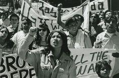 M&TC: WCW A Chicana Brown Beret leading a march in Sacramento at La Marcha de la Reconquista. 1969.