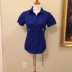 Blue puffed sleeve top Ties in back for a very fitted look. NWOT Never worn. FANG Tops