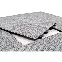 Immediately transform your basement into an attractive living space with interlocking carpet floor tiles. These durable carpet square basement tiles are easy to install and maintain. Your basement will look polished with these tiles made in the USA.