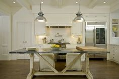 Great Kitchen table. Very similar to the Modern Farmhouse table from Anthropologie. By Arcanum Architecture