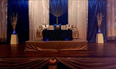 Royal Blue and Bronze Gold Indian Wedding Stage Feature