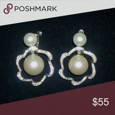 """Vintage Rhinestone Pearl Runway Bridal Earrings Vintage glitzy chunky rhinestone & faux pearl earrings that are 2-die-4. All pave' set stones in silver plated flower shaped setting with large faux pear center drop. These are really stunning on and have a smaller pearl at the top of the screw back pull back clips. These are Red Carpet all the way, big, showy and perfect for the special occasions! Measures 2 1/2"""" by 1 1/8"""" and are in wonderful vintage condition! Vintage Jewelry Earrings"""