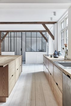 Big fan of this whole thing. See sink (love that inlay). What do we think of that type of separation between the kitchen and the art space? Might be my French fix without trying to find parquet flooring. Kitchen Interior, Home Interior Design, Kitchen Design, Barn Kitchen, Wooden Kitchen, Scandinavian Kitchen, Minimalist Kitchen, Kitchen On A Budget, Kitchen Remodel
