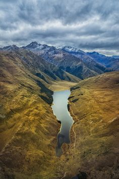 A chopper flight (with Choppy!) from Queenstown to Glenorchy can take you over a few hidden lakes. Here is one of them, looking amazing in this strange light one afternoon. One cool secret thing about this lake is there is a tiny little hut at the end where you can stay for the night. - Glenorchy, New Zealand - Photo from #treyratcliff Trey Ratcliff at http://www.StuckInCustoms.com