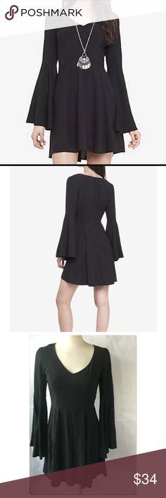 Express Bell Sleeve Fit & Flare Dress Express  Fit & Flare Dress  Over sized bell sleeves  Unlined Zip back entry  Nwot $68  V neck  Size 2 100% Rayon Express Dresses