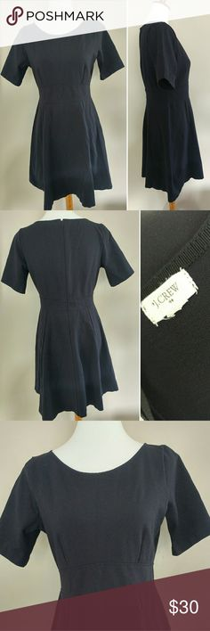 J.Crew Factory Navy Blue SZ S Fit and Flare Dress Women's J.Crew Factory size small navy blue short sleeved Ponte?stretchy fit and flare dress. Dress has a back zipper enclosure. Dress is in excellent pre-owned condition with no flaws. Size tag was cut - out (it is a size small) - but double check comprehensive measurements below.  Fast shipping - same or next business day. Thanks!  Measurements  Shoulder Seam to Shoulder Seam:13 inches Armpit to armpit: 17 inches Waist: 15 inches Length: 35…