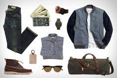 Garb: Write Away  Gustin Navy Baby Gingham Shirt ($76). Gustin Japan Denim Jeans ($89). Gustin Black Roller Belt ($51). Gustin Duffle Bag ($127). Oak Street Bootmakers Camp Boot ($348). J.Crew Wallace & Barnes Bomber Jacket ($188). Corter Leather Luggage Tag ($18). Garrett Leight California Optical Sunglasses ($315). ($249). Omega SS Speedmaster Watch ($5,850). Vintage New York City Postcards ($20).