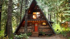 With a s'mores-ready fire pit and outdoor tub under the evergreens, this woodsy cabin was meant for soaking in summer's moments. Cabins In The Woods, House In The Woods, Cabins In The Mountains, Stone Cabin, Outdoor Tub, Forest Cabin, Cabin Kits, A Frame House, Cabins And Cottages