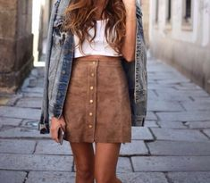 Suede nude button up skirt, white crop top, and denim jacket