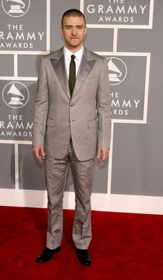 "What Your Favorite Stars Wore to the Grammys in 2007: The 2007 Grammy's were a prime example of ""OMG, what were we thinking?!"" as bedazzled sandals, ill-fitting trousers, and babydoll dresses reigned supreme. -- Justin Timberlake in Prada suit. 