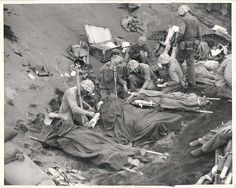 1945. Navy doctors and corpsmen give plasma and whole blood to wounded U.S. Marines at a forward casualty station on Iwo Jima.
