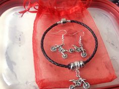 Motorbike Charm Bracelet & earrings by CreativeSoulSOT on Etsy https://www.etsy.com/listing/240474545/motorbike-charm-bracelet-earrings