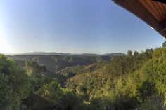 The view from Cliffhanger Cottage overlooking the forest to the Outeniqua Mountains beyond.