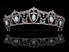 Anhalt opal honeysuckle tiara.  Either the original version of this tiara was entirely diamonds where flowers predated the hanging opal drops, or this is an adaptable tiara with multiple forms - see Diamonds III for the all-diamond version and the Tiaras - Adaptable for both forms.
