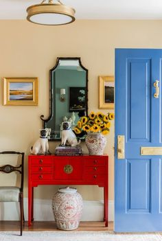 Colorful Foyer Decor with Red Table, Blue Door, Yellow Frames, and Mirror - Best Entry Table Decor Ideas: How To Decorate A Foyer Entryway Table For A Perfect Front Door Entrance Area Entrance Table, Entry Tables, Best Front Door Colors, Foyer Decorating, Decorating Ideas, Entryway Decor, Entryway Mirror, Door Entry, Entryway Ideas