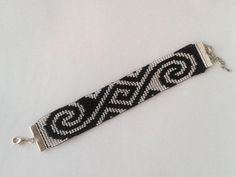 This beautiful bracelet is made on handlooms of fine Czech beads of black and silver. Bracelet width of cm, the length is adjustable from 17 to 22 cm. Crochet Beaded Bracelets, Bead Loom Bracelets, Beaded Jewelry Patterns, Bead Loom Patterns, Bead Crochet, Bracelet Patterns, Bead Jewellery, Seed Bead Jewelry, Beaded Bracelets
