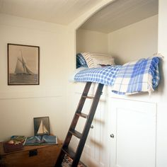bed nook with ladder and storage below