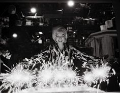 Marilyn Monroe celebrating her birthday on set. She often celebrated her birthdays while making films. She loved her career and those who supported her.
