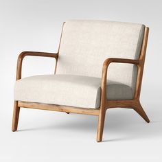 Add a unique seating solution to any space with the vintage-inspired charm of the Esters Wood Armchair from Project 62™. Constructed from wood in a warm distressed finish, this beautiful upholstered armchair features a padded seat and back to keep you comfortable whether you're reading, watching TV or just hanging out. Whether in your living room or as an accent piece in your entryway, you'll love the stylish touch this piece brings to your decor.