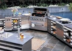 this outdoor kitchen on our wrap around deck and a water feature!  pure bliss.