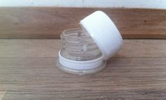 Make your own mini cosmetic container from a soda bottle!