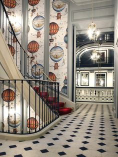 The staircase at the Saint James Hotel in Paris is class in a fantastic Pierre Frey (duh) hot air balloon paper and the whole thing is really just making my heart skip a few beats.