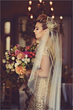 Gorgeous gold glitter wedding gown. Just stunning. Teamed with that massive floral bouquet, absolutely to die for!