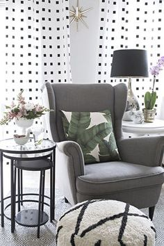 metal nesting tables, Ikea Strandmon chair, palm print pillow, moroccan pouf, black and white curtains - Cuckoo4Design