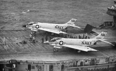 Two CVG-19 VF-193 Ghost Riders F3H-2 Demon on the catapults about to launch aboard USS Bon Homme Richard (CVA31) 1961