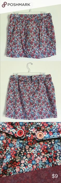 Floral skirt with buttons Promod brand skirt with red white pink and blue flowers. Zips in back and has pockets! Soft, fitted but not tight, super cute. UK size converts to US size 6/8 but fits smaller more like a 2/4. Promod Skirts Midi