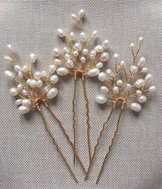 A set of hand made bridal pearl hair pins, decorated with various size ivory freshwater pearls. Perfect for a simple bridal hairstyle and also ideal for bridesmaids. Comes as a set of three hair pins. Approximate length and width of the detail: 4.5cm x 3.5cm. Complete with