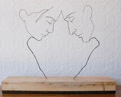 """Self-taught artist Gavin Worth creates wire sculptures that, from the right angle, look a lot like contour drawings. Each of his """"freestanding line drawings"""" depicts a simple human moment."""