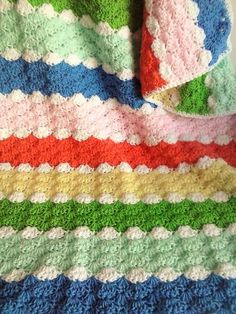 Repeating rows of pastel stripes form a subtle rainbow in this pretty shell blanket. The beautiful shell stitch gives the blanket an overall raised fan design. - Originally made as a custom order, this blanket is just too pretty not to have a place in my shop. Made using super soft 100% acrylic baby Crib Blanket, Baby Blanket Crochet, Crochet Baby, Crochet Blankets, Neutral Baby Blankets, Crochet Shell Stitch, Gender Neutral Baby, Blanket Sizes, Receiving Blankets