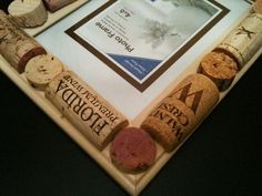 Unique hand crafted photo frame embellished with corks from various wines:  Walnut Crest, Florida Premium Wine, Menage a Trios, Alexander Vineyards and others.     