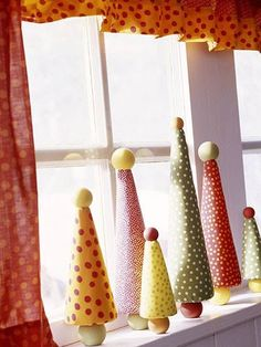 These miniature versions of full-size trees make it easy to add Christmas spirit to any room in the house.