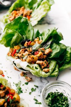 Springtime Basil Chicken Lettuce Wraps - basil chicken stuffed in lettuce wraps with garlic, red chilies, and sweet pineapple to tame that heat! The perfect protein-packed, low carb meal! Lettuce Wrap Recipes, Chicken Lettuce Wraps, Lunch Recipes, Healthy Dinner Recipes, Chicken Wraps, Clean Eating Snacks, Healthy Eating, Healthy Food, Veggie Hummus Wrap