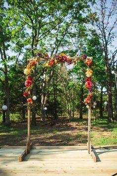 Rustic wedding by Anna Lee Media   Wedding altar with bright wildflowers #weddings