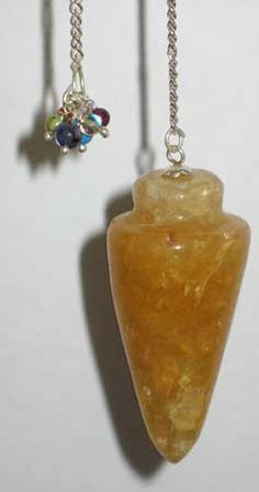 "Golden Topaz is a beautiful, yellow stone revered for bringing abundance and encouraging practicality. Here it has been used to create a bob for a pendulum, resulting in a divination and dowsing tool perfectly suited for helping you to find the practical answers to whatever questions you need answered. Each gemstone bob measures approximately 1"" long, with the entire pendulum measuring approximately 7"" long in total. $7.95"
